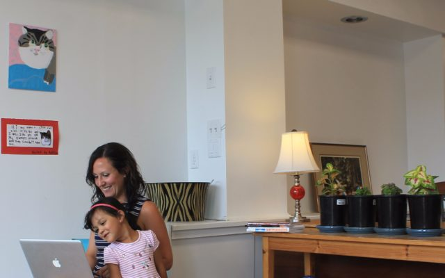 Lillie Lavado, owner of Hardscrabble Solutions in Presque Isle, seen here with her daughter Saraphina, works as a freelance web designer and opened the family-friendly co-working space in May. (Anthony Brino)
